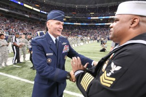 Gen. Carlton D. Everhart, Commander, Air Mobility Command, Scott Air Force Base, Illinois, (L) congratulates Navy recruiter 1st Class Gerald Wilson, Ret. after singing the National anthem before the Chicago Bears-St. Louis Rams football game at the Edward Jones Dome in St. Louis on November 15, 2015.   Photo by Bill Greenblatt/UPI