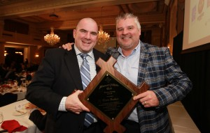 St. Louis Blues radio play-by-play man Chris Kerber (L) is presented the Missouri Athletic Club's Burnes-Broeg Award by former Blues player Kelly Chase, during ceremonies in St. Louis on December 16, 2015. Photo by Bill Greenblatt/UPI