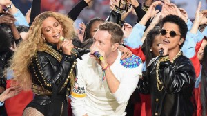 SANTA CLARA, CA - FEBRUARY 07:  (L-R) Beyonce, Chris Martin of Coldplay and Bruno Mars perform onstage during the Pepsi Super Bowl 50 Halftime Show at Levi's Stadium on February 7, 2016 in Santa Clara, California.  (Photo by Jeff Kravitz/FilmMagic)