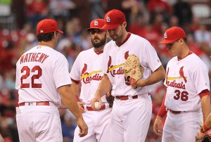 St. Louis Cardinals starting pitcher Michael Wacha hands the baseball off to manager Mike Matheny as he comes out of the game aginst the Chicago Cubs in the fifth inning at Busch Stadium in St. Louis on May 24, 2016. Photo by Bill Greenblatt/UPI