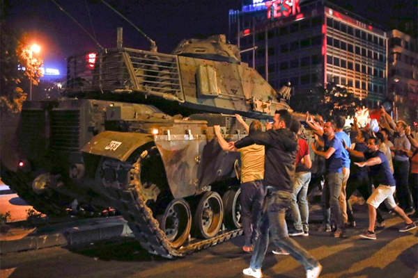 Turkey coup attempt: People react near a military vehicle during an attempted coup in Ankara, Turkey. (Source: Reuters)