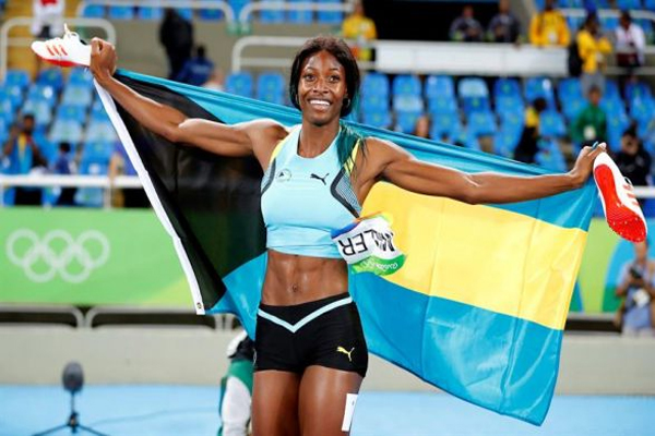 Shaunae Miller of the Bahamas celebrates after winning the women's 400m final of the Rio 2016 Olympic Games Athletics, Track and Field events at the Olympic Stadium in Rio de Janeiro, Brazil, 15 August 2016. EPA/DIEGO AZUBEL