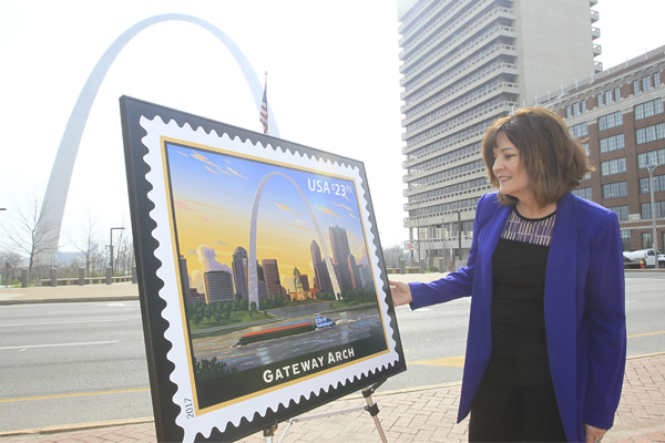 Cathy Vaughn, Postmaster of St. Louis, gets a closer look at the new priority Mail Express stamp featuring the Gateway Arch, in St. Louis on March 21, 2017. The stamp art depicts the stainless-steel arch at sunset in its setting on the banks of the Mississippi River. Photo by Bill Greenblatt/UPI
